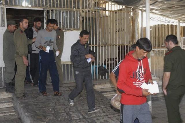 Cette photo de l'agence officielle syrienne Sana montre... (Photo AP/SANA)