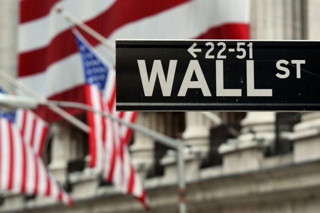 Wall Street a terminé en légère hausse vendredi, aidée par les bonnes... (PHOTO STAN HONDA, AFP)