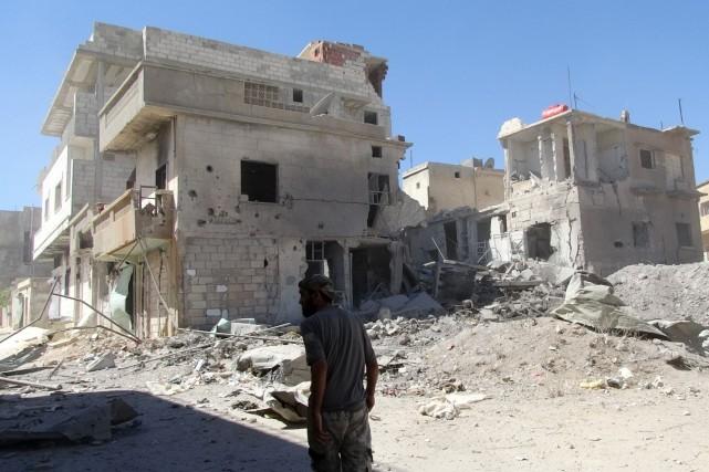 L'aviation syrienne a pilonné jeudi Mleiha, au sud-est de Damas, un bastion... (Photo ABU AMAR AL-TAFTANAZ, AFP)