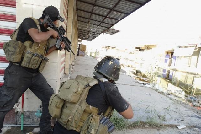 Un double attentat a fait six morts dimanche près de Ramadi, dans l'ouest de... (Photo REUTERS)