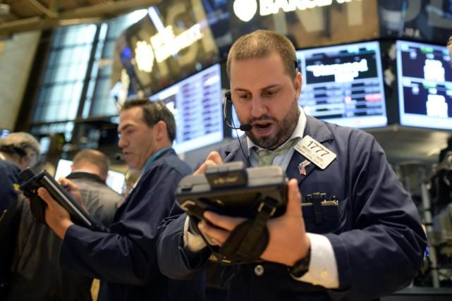 Rassurés par la politique hyper accommodante des banques... (PHOTO TIMOTHY CLARY, archives AFP)