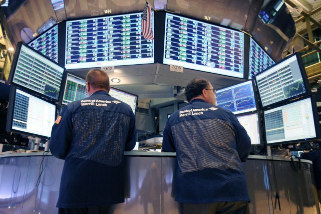 Wall Street a nettement reculé mardi, basculant dans le rouge en fin de séance... (Photo Henny Ray Abrams, Archives Associated Press)