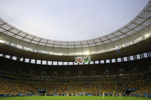 Contrairement aux craintes initiales, la Coupe du monde brésilienne se déroule... (PHOTO ADRIAN DENNIS, AFP)
