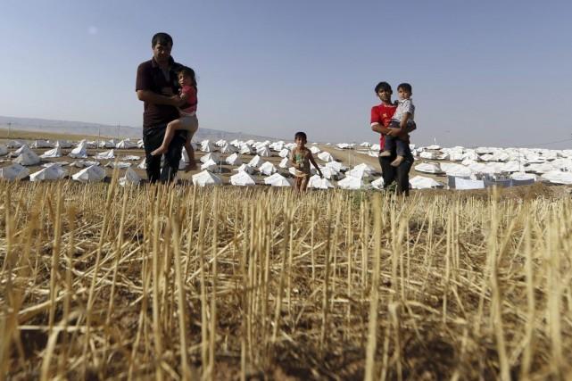 Des réfugiés irakiens dans un camp.... (Photo AFP)