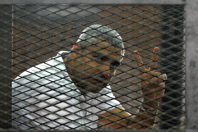 Le journaliste Canado-Égyptien Mohamed Fahmy purgera un peine... (Photo Associated Press)