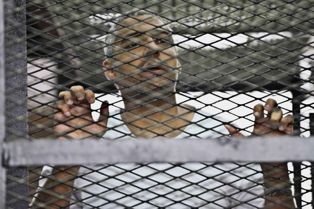 La justice égyptienne reproche aujournaliste canado-égyptien, Mohamed Fahmy... (PHOTO HAMADA ELRASAM, ARCHIVES AP)