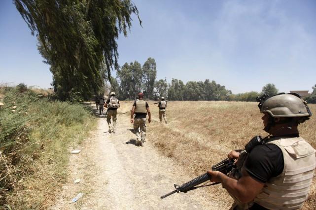 Des soldats de l'armée irakienne lors de combats... (Photo Ahmed Saad, Reuters)