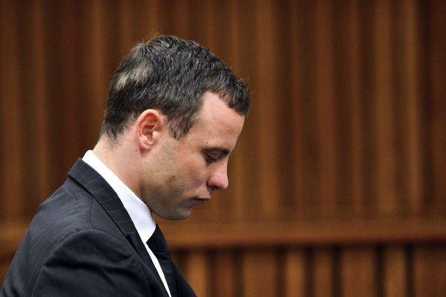 Oscar Pistorius, dont le procès pour le meurtre de sa petite amie a repris... (PHOTO PHILL MAGAKOE, AFP)