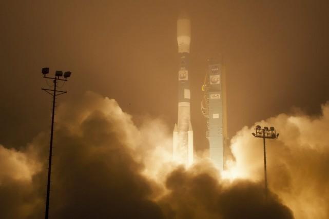 Le lanceur transportant le satellite, une fusée Delta... (PHOTO BILL INGALLS, AGENCE FRANCE-PRESSE)