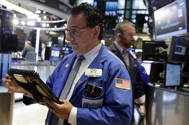 La Bourse de New York a emmené les indices Dow Jones et S&P 500 à des niveaux... (Photo Richard Drew, Associated Press)