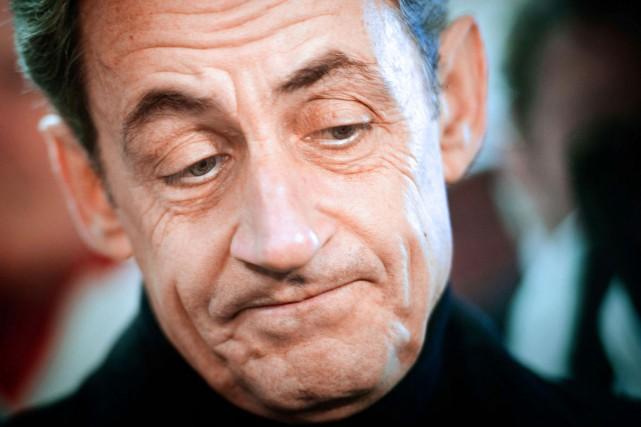 Nicolas Sarkozy, en banlieue parisienne, en février 2012.... (PHOTO LIONEL BONAVENTURE, ARCHIVES AFP)