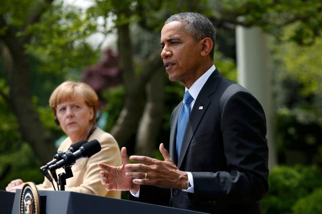 La chancelière allemande Angela Merkel et le président... (PHOTO KEVIN LAMARQUE, ARCHIVES REUTERS)