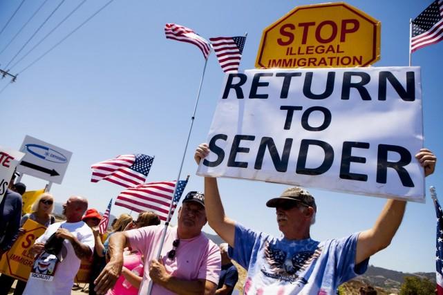 Équipés de pancartes où l'on peut lire «à... (PHOTO SAM HODGSON, ARCHIVES REUTERS)