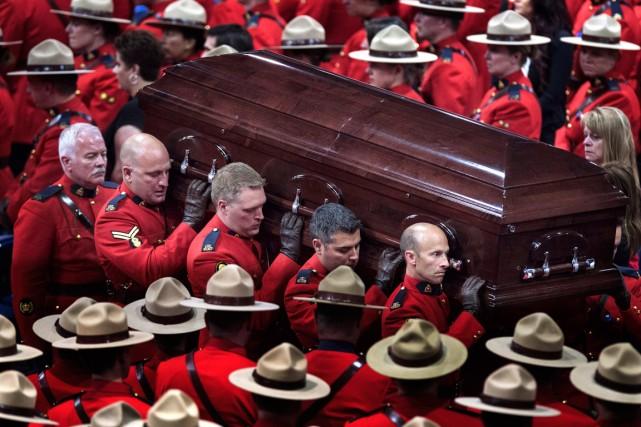 Les funérailles des trois agents de la GRC... (Photo Andrew Vaughan, La Presse Canadienne)