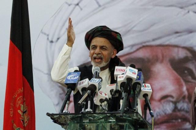Abdullah Abdullah, qui a pris la tête lors... (PHOTO ALLAUDIN KHAN, ARCHIVES AP)