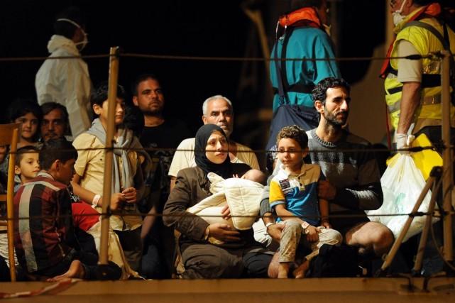 La présence de femmes et d'enfants parmi les... (PHOTO GIOVANNI ISOLINO, ARCHIVES AFP)