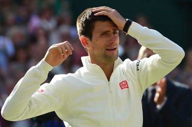 Novak Djokovic a fondu en larmes après avoir... (Photo Carl Court, AFP)