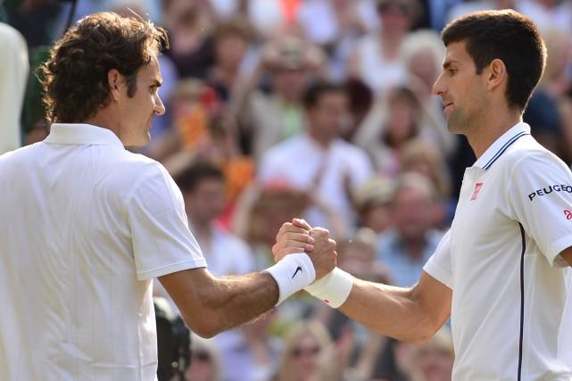 Djokovic, champion de Wimbledon, et le Suisse Roger... (Photo CARL COURT, AFP)