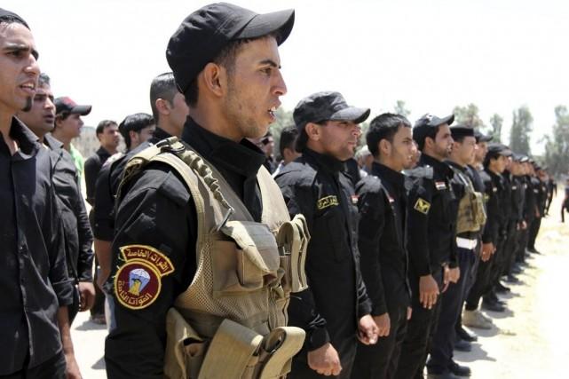 Des volontaires chiites du Hezbollah irakien ont rejoint... (PHOTO REUTERS)