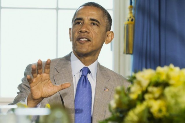 M.Obama doit demander mardi au Congrès le financement... (PHOTO JACQUELYN MARTIN, AP)