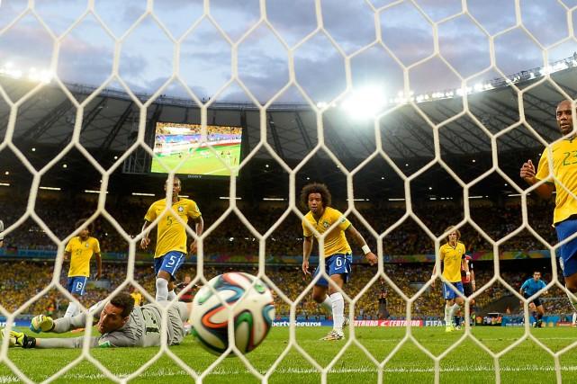 Le Brésil a subi une raclée de 7-1... (Photo Adrian Dennis, AFP)