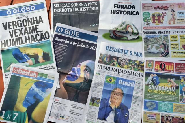 Les Unes des journaux brésiliens au lendemain de... (Photo Evaristo Sa, AFP)