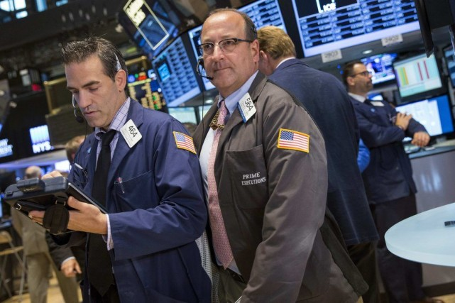 Dans le sillage des Bourses européennes, la place... (PHOTO BRENDAN MCDERMID, REUTERS)