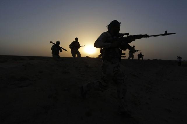 Alors que l'Irak se dirige vers la partition et que le chef de l'État islamique... (Photo ALAA AL-MARJANI, Reuters)