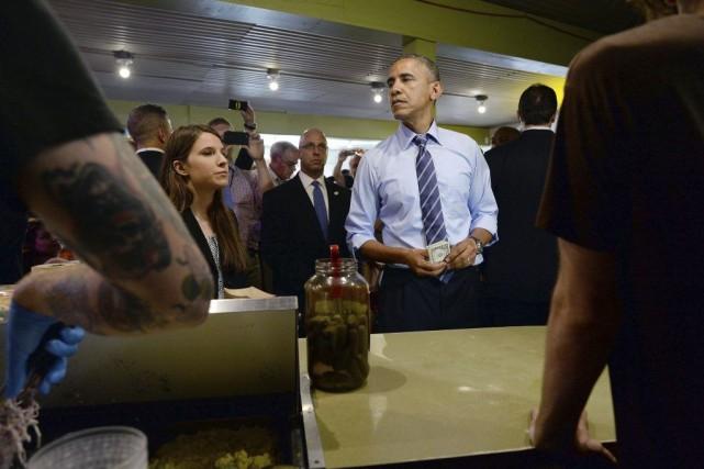 Obama a offert de payer le repas de... (Photo AFP)