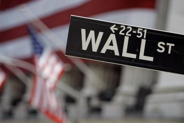 Wall Street a terminé en légère hausse vendredi, hésitant à s'engager... (Photo archives AP)