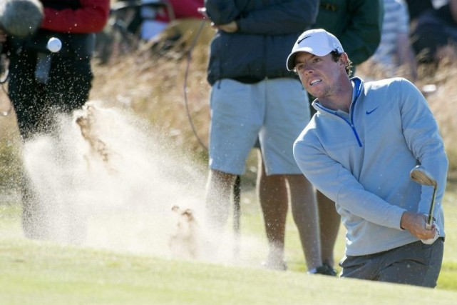 McIlroy avait signé une carte record de 64... (PHOTO KENNY SMITH, AP)