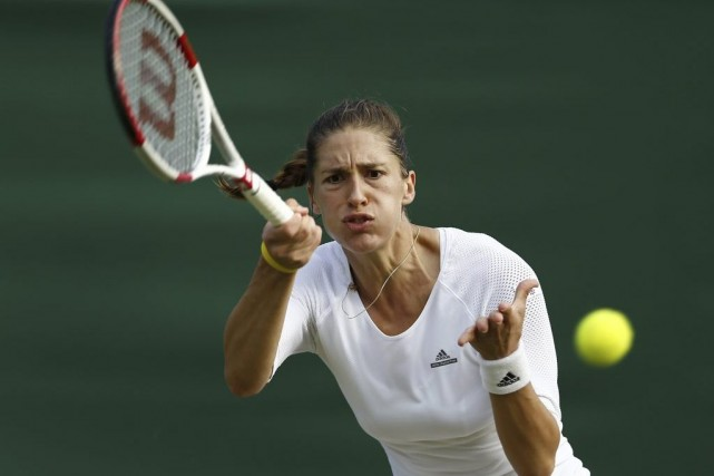 Andrea Petkovic... (PHOTO ANDREW COWIE, AFP)