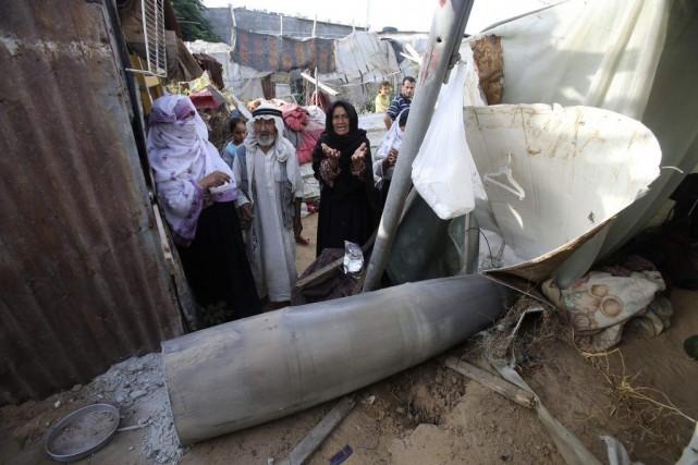 Les bombardements israéliens ont fait 172 morts et... (Photo Ibraheem Abu Mustafa, Reuters)
