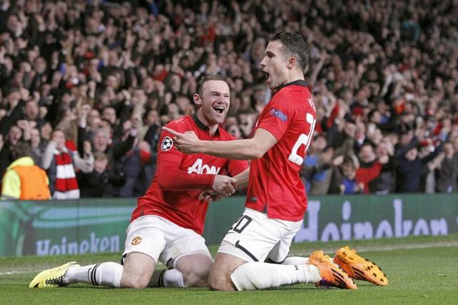Wayne Rooney et Robin van Persie, de Manchester... (Photo Peter Byrne, archives AP)