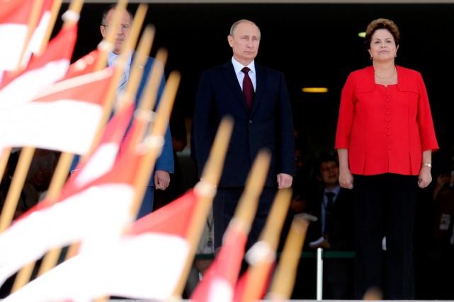 Dilma Rousseff (à droite) et Vladimir Poutine ont... (PHOTO EVARISTO SA, AGENCE FRANCE-PRESSE)