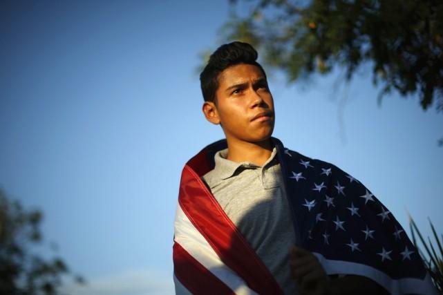 William Bello, 16 ans, participe à une vigile... (PHOTO LUCY NICHOLSON, ARCHIVES REUTERS)