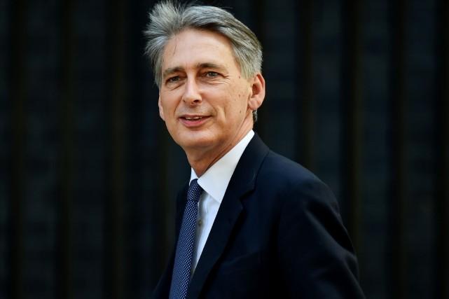 Philip Hammond devient le nouveau ministre britannique des... (PHOTO BEN STANSALL, AFP)