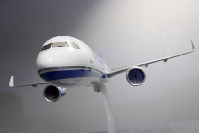 Une maquette du Airbus A330-900 NEO exposée ausalon... (LEON NEAL)