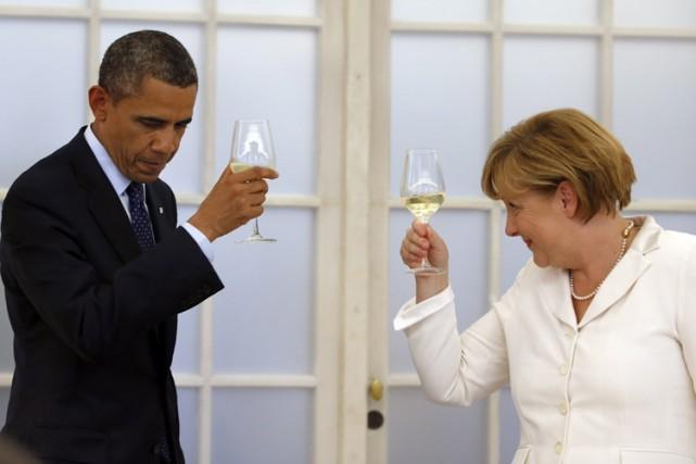 Barack Obama et Angela Merkel lors d'un évènement... (Archives Reuters)