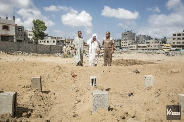 Namen al-Batsh, qui a perdu 18 membres de... (PHOTO OLIVIER PONTBRIAND, LA PRESSE)