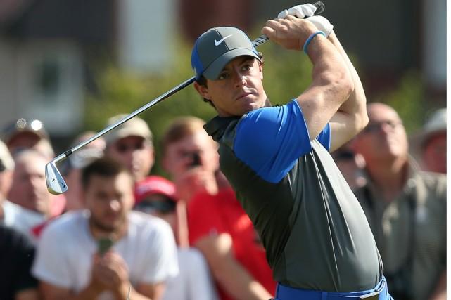 Fidèle à ses habitudes en tournois majeurs, Rory... (Photo Andrew Yates, AFP)