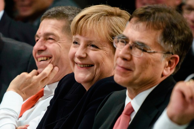 Angela Merkel, son mari husband Joachim Sauer (à... (PHOTO CLEMENS BILAN, AGENCE FRANCE-PRESSE)