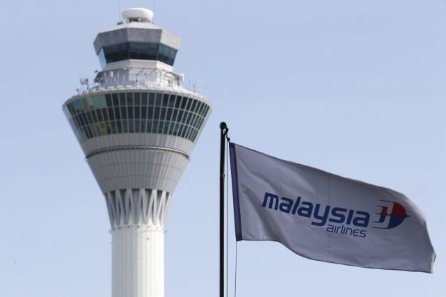 Un avion de la compagnie aérienne malaisienne parti... (PHOTO ARCHIVES OLIVIA HARRIS, REUTERS)