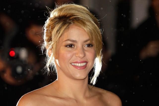 La chanteuse colombienne a participé à la cérémonie... (PHOTO LIONEL CIRONNEAU, ASSOCIATED PRESS)