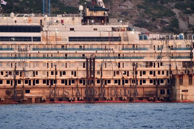 Propriété de l'armateur italien Costa, qui appartient lui-même... (Photo GIUSEPPE CACACE, AFP)