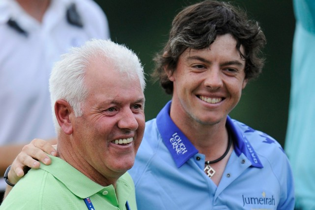 Rory McIlroy et son père Gerry.... (Photo Nick Wass, archives AP)