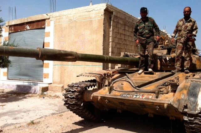 Des soldats des Forces loyales au président Bachar... (PHOTO ARCHIVES AGENCE FRANCE-PRESSE)