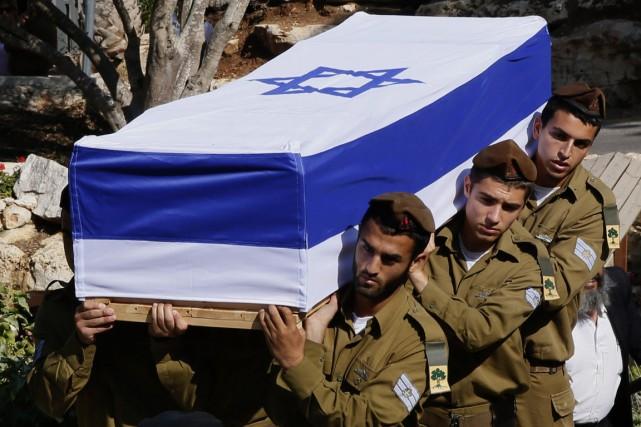 Une atmosphère de deuil régnait lundi en Israël... (PHOTO GALI TIBBON, AFP)