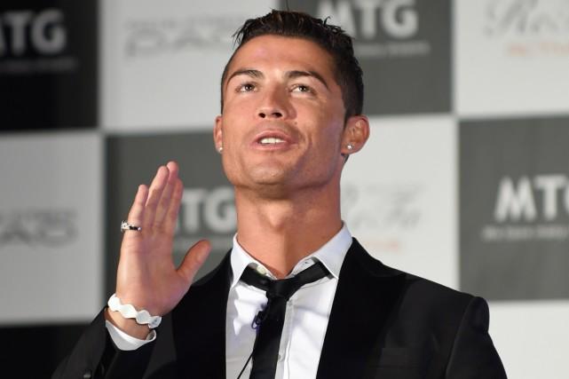 Cristiano Ronaldo était de passage au Japon mardi... (Photo Toru Yamanaka, AFP)