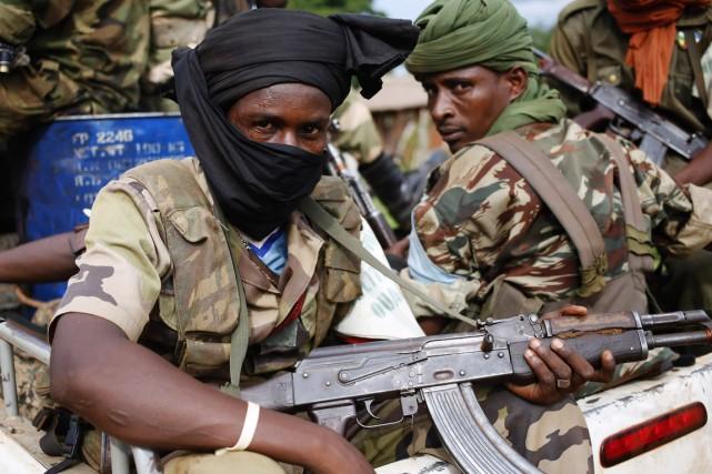 Des combattants de l'ex-rébellion Séléka, sur la route... (PHOTO GORAN TOMASEVIC, ARCHIVES REUTERS)
